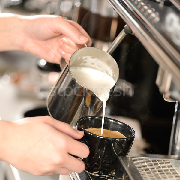 Waitress hands pouring milk making cappuccino Stock photo © CandyboxPhoto