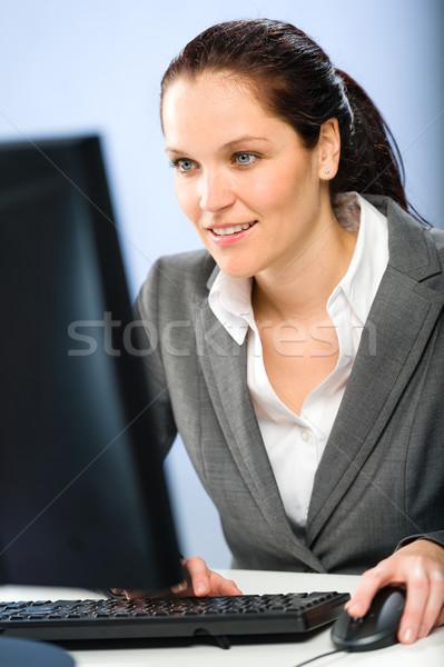 улыбаясь деловая женщина рабочих компьютер занят мыши Сток-фото © CandyboxPhoto