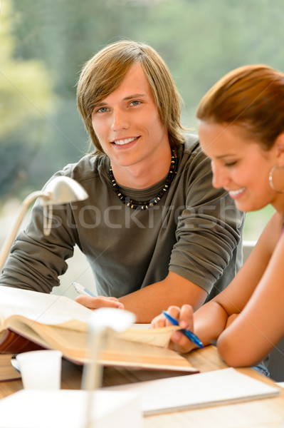 Teens reading book studying in high-school library Stock photo © CandyboxPhoto
