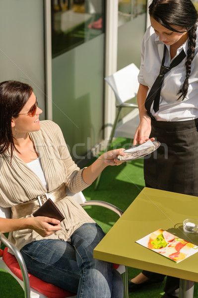 Woman paying bill to waitress cafe restaurant Stock photo © CandyboxPhoto