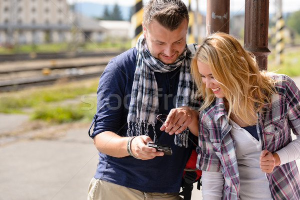 Man showing woman pictures on digital camera Stock photo © CandyboxPhoto