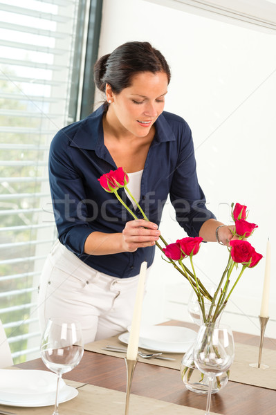 Young woman arranging flowers dinner table Stock photo © CandyboxPhoto