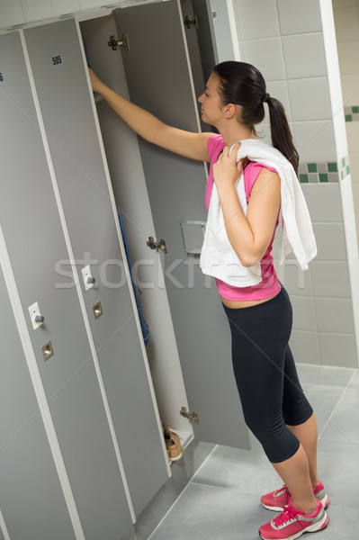 Woman opening locker at gym Stock photo © CandyboxPhoto
