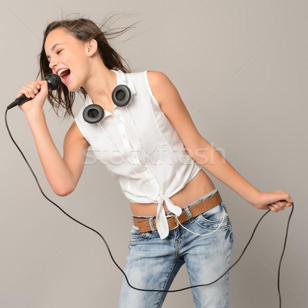 şarkı söyleme genç kız mikrofon karaoke müzik gri Stok fotoğraf © CandyboxPhoto