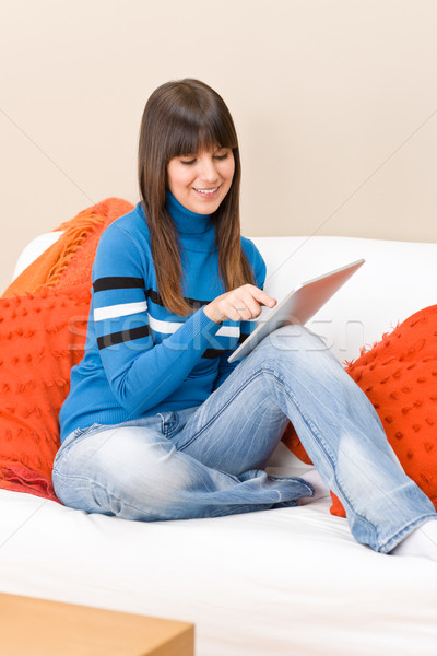 Stock photo: Teenager girl relax home with touch screen tablet computer