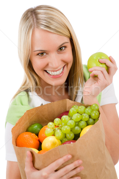 Healthy lifestyle - cheerful woman with fruit shopping bag Stock photo © CandyboxPhoto