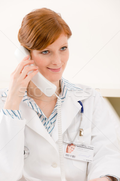 Doctor office - female physician make phone call Stock photo © CandyboxPhoto
