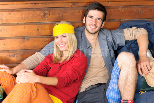 Tramping young couple backpack relax by cottage Stock photo © CandyboxPhoto