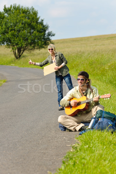 Hitch-hiking young couple backpack asphalt road Stock photo © CandyboxPhoto