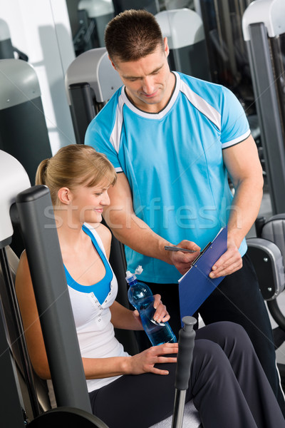Check fitness exercise plan with personal trainer Stock photo © CandyboxPhoto