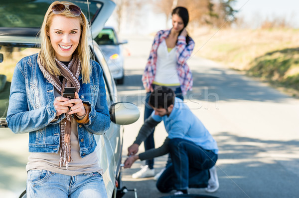 Puncture wheel man helping two female friends Stock photo © CandyboxPhoto