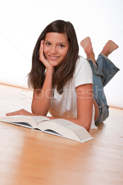 Happy teenager lying down with book  Stock photo © CandyboxPhoto