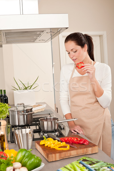 Happy woman biting red pepper in modern kitchen Stock photo © CandyboxPhoto