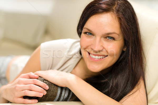 Serene cheerful woman lying on couch Stock photo © CandyboxPhoto