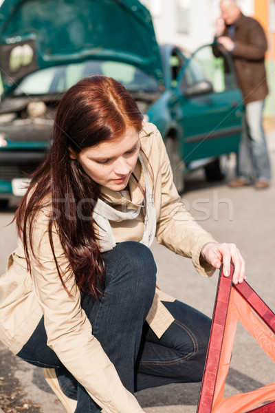 Woman putting triangle sign for car breakdown Stock photo © CandyboxPhoto