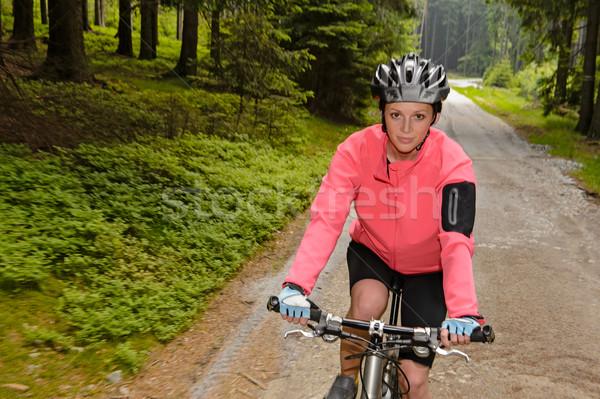 Mulher mountain bike floresta estrada borrão movimento Foto stock © CandyboxPhoto