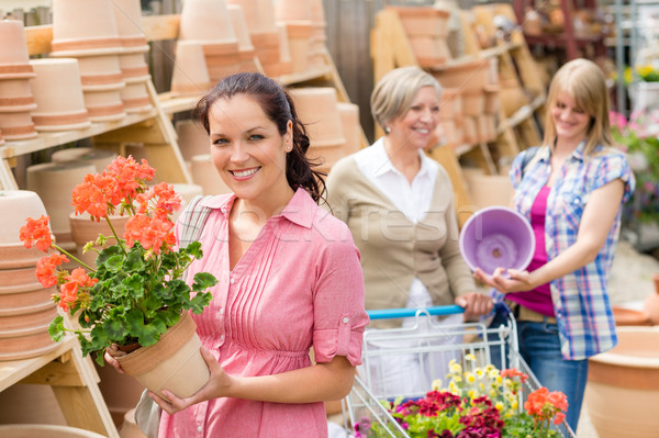 Garden centre woman hold red potted geranium Stock photo © CandyboxPhoto