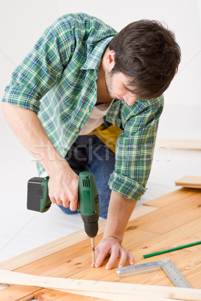 Home improvement - handyman installing wooden floor Stock photo © CandyboxPhoto