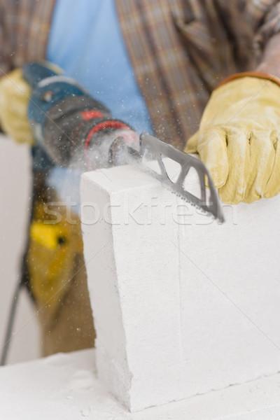 Melhoramento da casa handyman cortar tijolo serra Foto stock © CandyboxPhoto