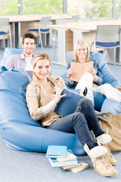 Group of high-school students with books sitting Stock photo © CandyboxPhoto