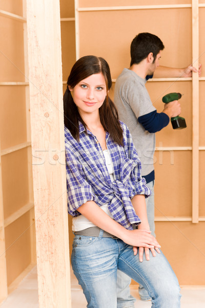 Stock photo: Home improvement young couple fixing wall
