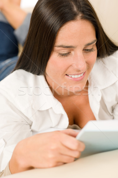 Smiling mid-aged woman read book on sofa  Stock photo © CandyboxPhoto