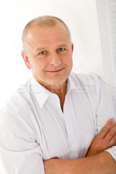 Mature businessman smile cross arms posing Stock photo © CandyboxPhoto