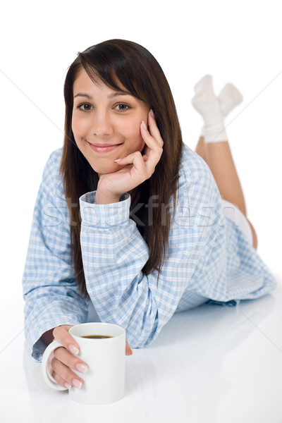 Stock photo: Happy young woman with coffee in pajamas