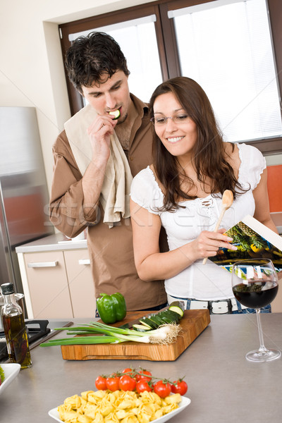 Smiling couple in modern kitchen cook together Stock photo © CandyboxPhoto