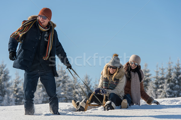 Young people enjoy sunny winter day sledge Stock photo © CandyboxPhoto