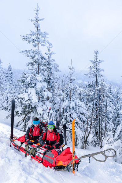 Ski patrol with rescue sled injured woman Stock photo © CandyboxPhoto