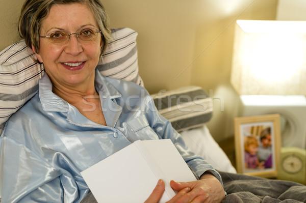 Staruszka piżama bed patrząc kamery kobieta Zdjęcia stock © CandyboxPhoto
