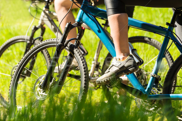 Stock photo: Mountain bikers wearing cycling shoes closeup