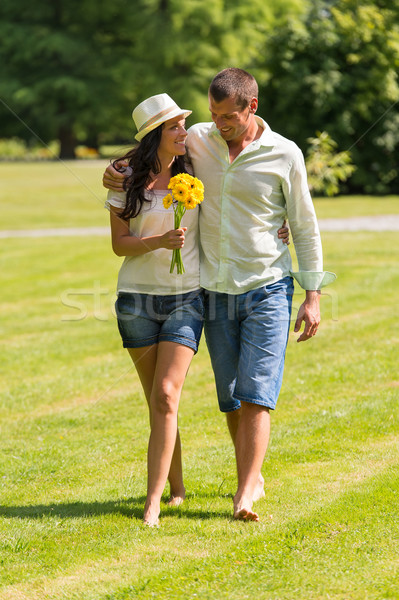 Young couple walking in park barefoot  Stock photo © CandyboxPhoto