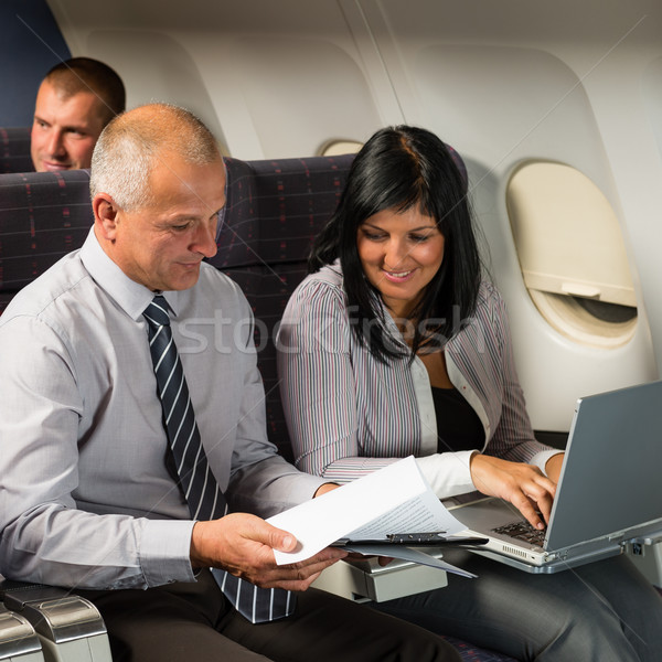 Businesspeople working on computer flight airplane Stock photo © CandyboxPhoto