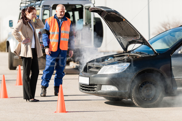 Woman with technician help smoking car engine  Stock photo © CandyboxPhoto