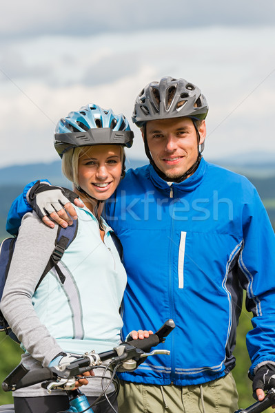 Young sporty couple with mountain bikes in helmet Stock photo © CandyboxPhoto