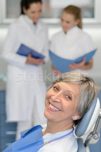 Senior mulher paciente dentista cirurgia sorridente Foto stock © CandyboxPhoto
