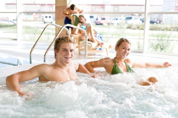Piscina casal relaxar banheira de hidromassagem jovem atraente Foto stock © CandyboxPhoto