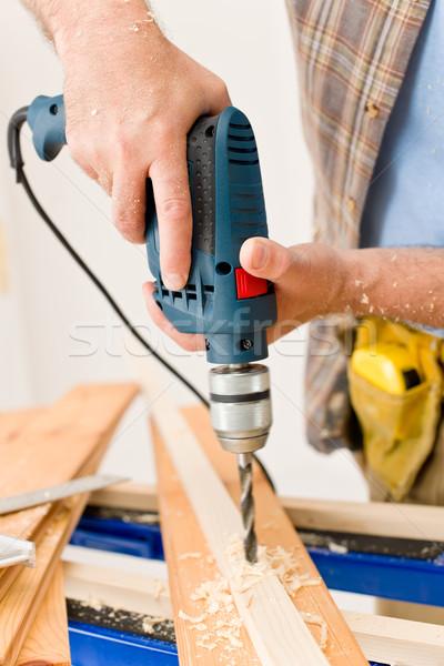 Stock photo: Home improvement - handyman drilling wood