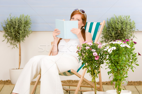 Summer terrace red hair woman read in deckchair Stock photo © CandyboxPhoto