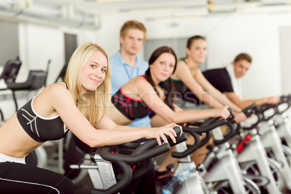 Young fitness people bike spinning with instructor Stock photo © CandyboxPhoto