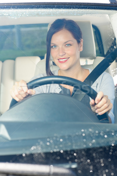 Stock photo: Attractive businesswoman drive luxury car smiling