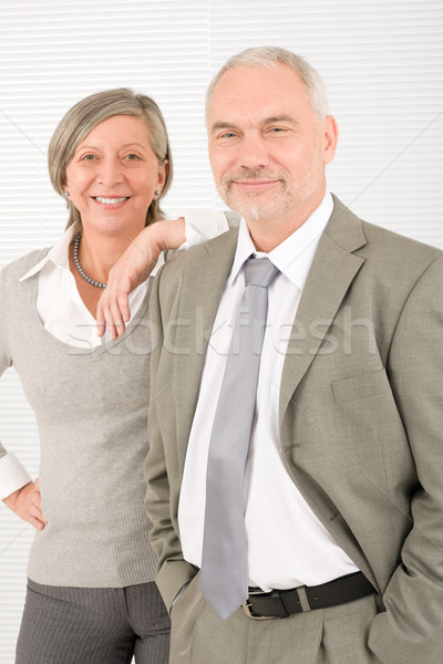 Senior businesspeople lean over shoulder colleague Stock photo © CandyboxPhoto