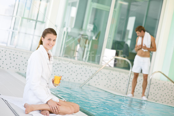 Swimming pool - young woman relax on poolside Stock photo © CandyboxPhoto