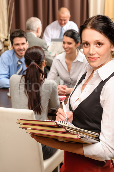 Waitress hold menu business people at restaurant Stock photo © CandyboxPhoto