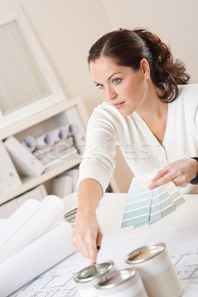 Stock photo: Female designer with color swatch at office
