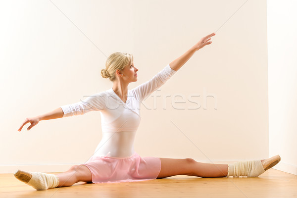 Ballet dancer lifting arms exercising in studio Stock photo © CandyboxPhoto
