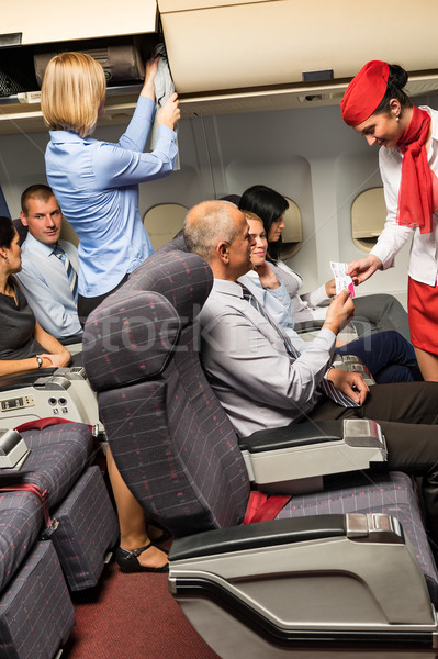 Flight attendant check passenger tickets cabin Stock photo © CandyboxPhoto