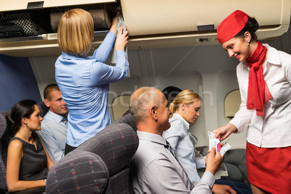 Air stewardess check ticket airplane cabin smiling  Stock photo © CandyboxPhoto